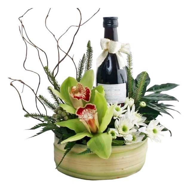 Flower Arrangements In Wine Bottles: Christmas Flowers
